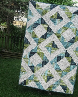 blue and green quilt. for me it would be done in black and white and red :)