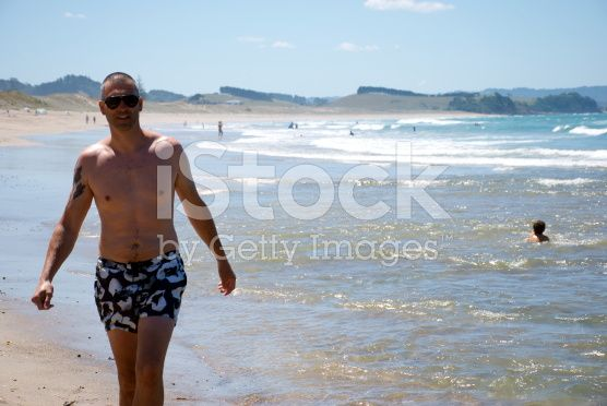 Man walks up Pataua Beach, Whangarei, Northland, New Zealand royalty-free stock photo