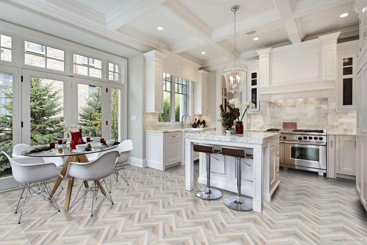 Tiles on a modern kitchen floor in a herringbone type pattern. Bright colours and open windows make this space look very fresh