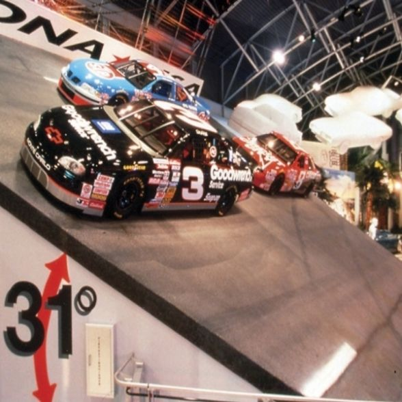 From an advertisement about Daytona Beach, the Ghost Cars landing on a section of track in the Daytona 500 Experience exhibit.