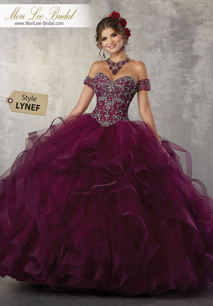 Style LYNEF Jewel Beaded Bodice on a Flounced Tulle Ballgown This Gorgeous Quinceañera Ballgown Features an Intricately Beaded Bodice Accented with Detachable Beaded Arm Cuffs. Matching Stole Included. Colors Available: Wine, Emerald, Blush, White