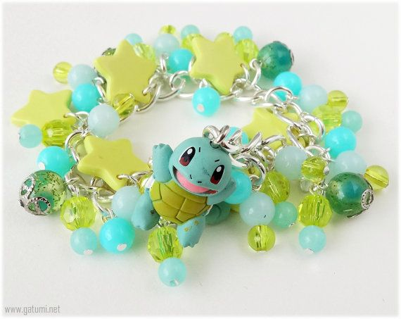Hey, I found this really awesome Etsy listing at http://www.etsy.com/listing/151901294/squirtle-charm-bracelet-teal-and-yellow