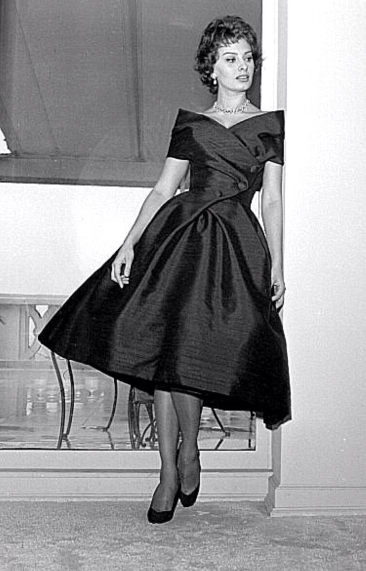 TEA-LENGTH COWEL NECK Dress Dior designer black dress full skirt portrait cowl collar off shoulder buttons 50s dress cocktail knee length silk satin designer couture movie star sophia loren fashion magazine print ad model photo