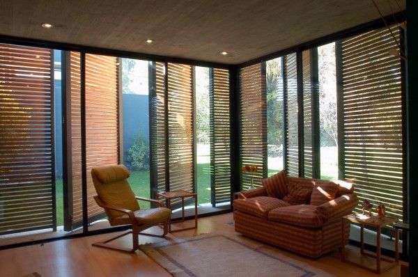I LOVE the shutters on this home/office cube, and the floor-to ceiling windows!  Located in Chile, it was designed by architects Claudio Labarca and Juan Ignacio Lopez. The interior space measures 5 by 7 meters which is about 375 square feet.