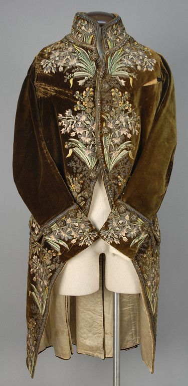Court suit, 1750-1775. Brown silk velvet extensively decorated with polychrome silk and silver metallic embroidery, embroidered buttons throughout, silk lining.