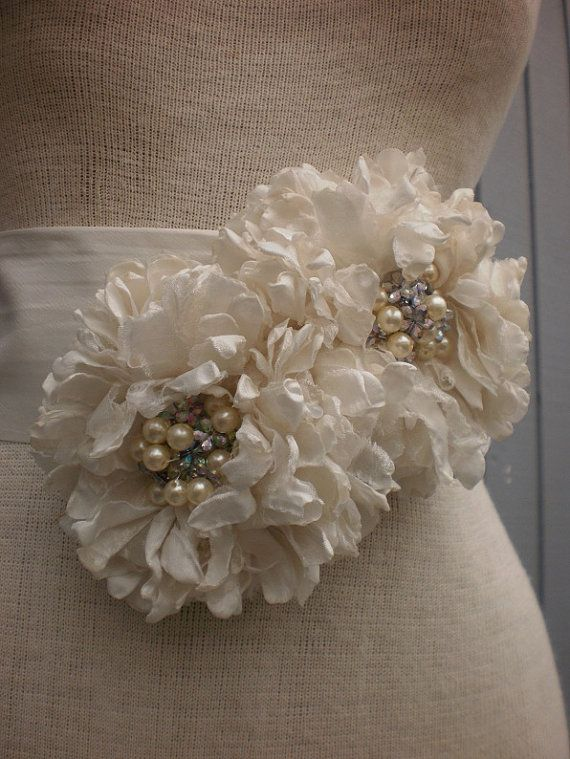 wedding Bridal Sash With two Unique Design Flowers Chose One of Five Different Color Sashes. $65.00, via Etsy.