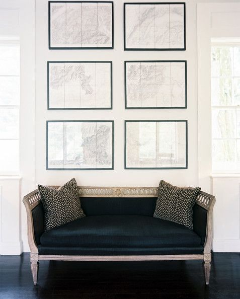 A simple display of topographical maps anchor the beautiful velvet settee to create a gorgeous vignette.