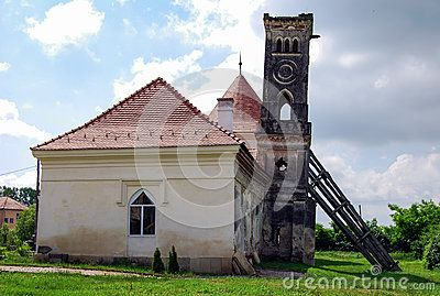 The lean tower of Bontida castle, in Transylvania, Romania. The old tower leans on one side, so it has been stabilized with a wood structure, so that it does not collapse.