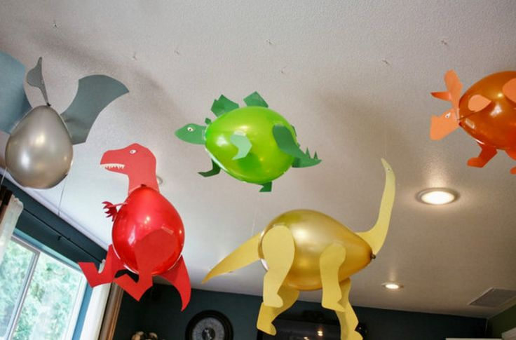 Creative Dinosaur Themed Party Ideas | Home Party Theme Ideas - these dinosaur balloons are a great money saving decor item that looks pretty easy to do especially if you have an electronic cutting machine.