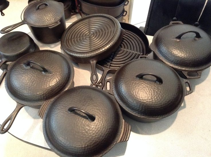 "Chicago Hardware shallow pattern with pointy handle set. Shown are 3 different variations of the #8 dutch oven. The different variations consist of different pot handles and lid handles. There is a 4th that has the traditional bail. (Not shown) A #8 chicken fryer skillet and lid. A 12"" broiler pan, and #3 and #5 regular skillet. Also shown is a sauce or deep fryer with lid."