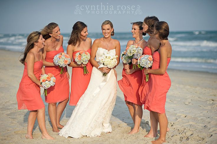 Coral bridesmaids dresses, hydrangea bouquets by Roger Carter ...