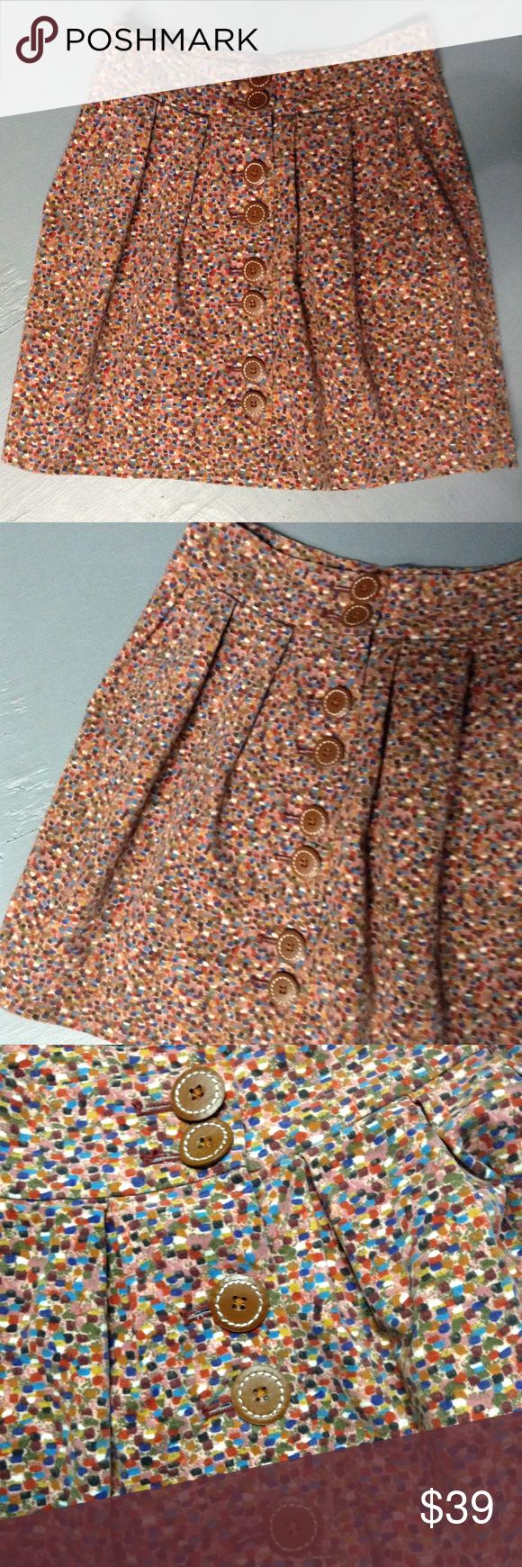 """elevenses ANTHROPOLOGIE velvet confetti skirt 0 2 Muted multicolor 'confetti' type pattern skirt, perfect for fall/winter. From Elevenses, sold only at Anthropologie. Machine washable 96/4 cotton/spandex. Fully lined (picture 6). The buttons are either leather or a good faux leather, it's hard to tell for sure, but they're so cute! Semi-full cut, with side slash pockets. Perfect condition! Tagged as 0, but fits most 2 as well: the waist measures 29.5"""", and it's 19"""" long. Anthropologie Skirts…"""