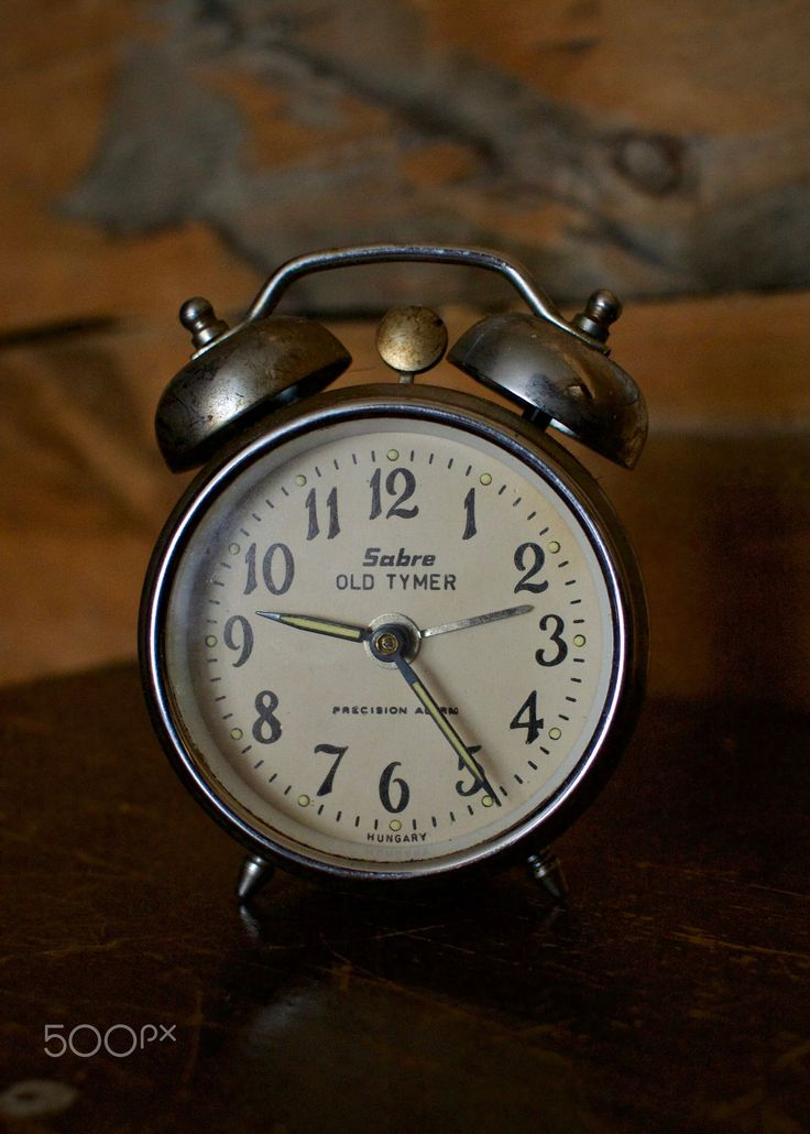 """""""Old Tymer"""" - An old alarm clock used by homesteaders in northern Alberta. It was in the kitchen of the farmhouse at the Nampa Museum."""