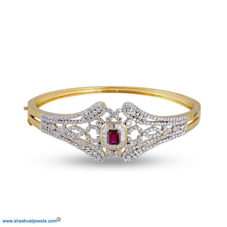 Beautiful and sparkling white diamonds surrounded around the single red ruby gem which makes this bangle a grand bangle meant for a grand moment. Suitable for any occasion at any time. #diamond #bracelet #for #her http://www.shashvatjewels.com/ProductDetail.aspx?prdid=1079&name=Grand%20Ruby%20Collection%20Women's%20Diamond%20Bracelet All our designs are available in white gold and silver..!!