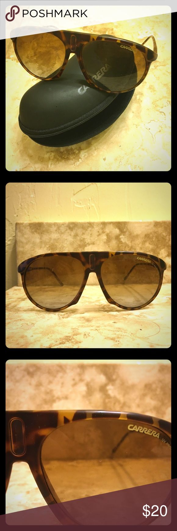 Authentic unisex Carrera sunglasses with case Authentic unisex Carrera sunglasses in tortoiseshell. Large frames, tortoiseshell pattern. The Carrera decal has fallen off of the bridge (above nose - see photos). Otherwise great shape. Comes with original case. Carrera Accessories Sunglasses