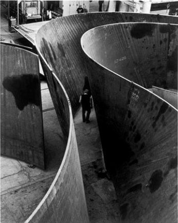 Richard Serra Sculpture; These pieces of steel are meant to be toured, inside-out. They are held up by mere physics and conform to the human form.
