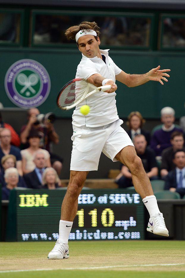 Roger Federer strikes a forehand against Novak Djokovic on Centre Court. - Matthias Hangst/AELTC