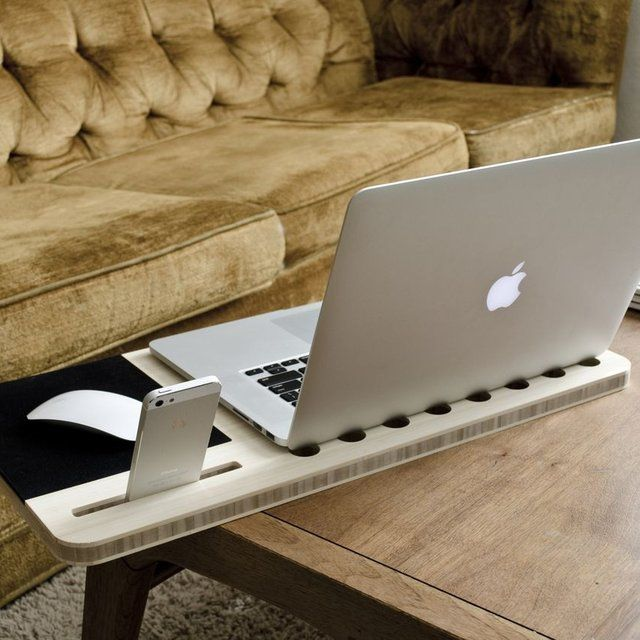Slate Mobile AirDesk  Designed for the kind of person who prefers to work from the sofa rather than the office, the Slate Mobile AirDesk is cut from premium bamboo and includes holes to keep your laptop cool and a slot for a smartphone. $110.