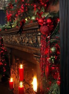 Love the hanging beads with the cluster...Holiday Mantel Decorating~red | This is GORG!!!