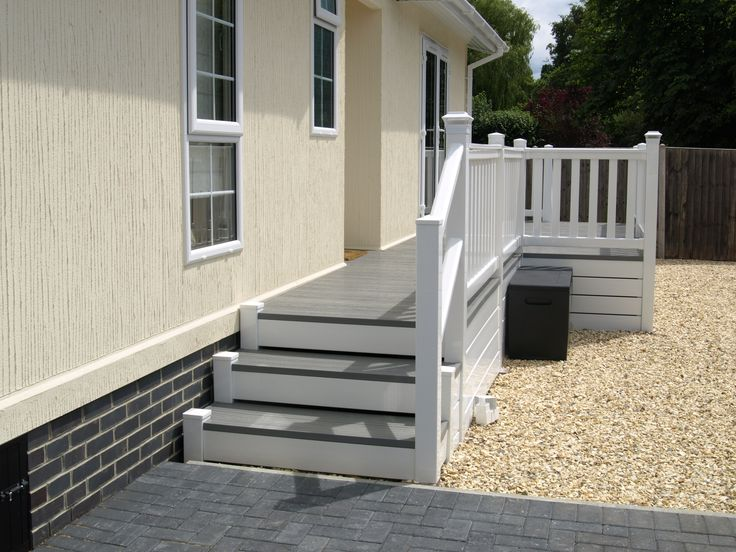 Fensys P shaped white and driftwood colour upvc plastic decking on park home