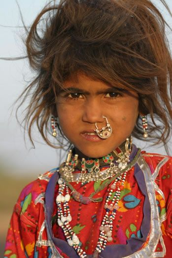 india.  the people may have a different idea about piercings but this girl is still absolutly beautiful!