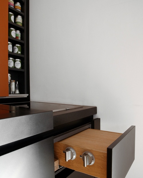 Hidden controls for the stove inside this Holzrausch designed kitchen.