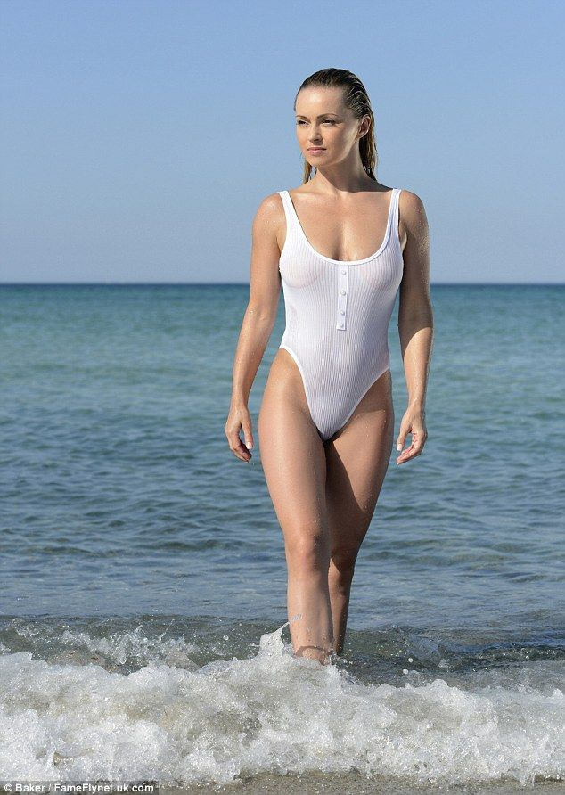 Baywatch moment: Another shot sees the Polish beauty modelling a white swimsuit, which turned almost transparent after a dip in the water