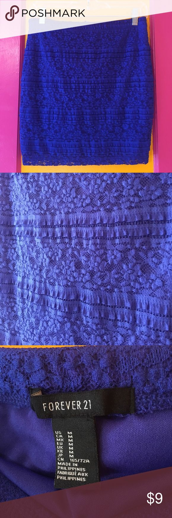Gorgeous Royal Blue Lace Mini Skirt Never worn and brand new condition! Very stretchy so could fit a size large as well. Features small frill and lace throughout Skirt. Is 16 in long. Forever 21 Skirts Mini