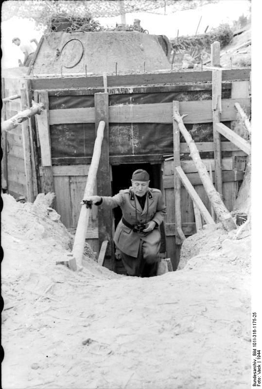 Benito Mussolini inspecting a defensive fortification, Italy, 1944. WWII