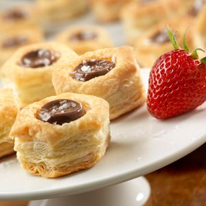 """""""Simply bake puff pastry cups and press the chocolate caramel candies down into the centers and let stand 5 minutes. A sprinkle of sea salt is the perfect finish for these delectable little dessert cups. Try using your own favorite candy in this easy, versatile and delicious recipe."""""""