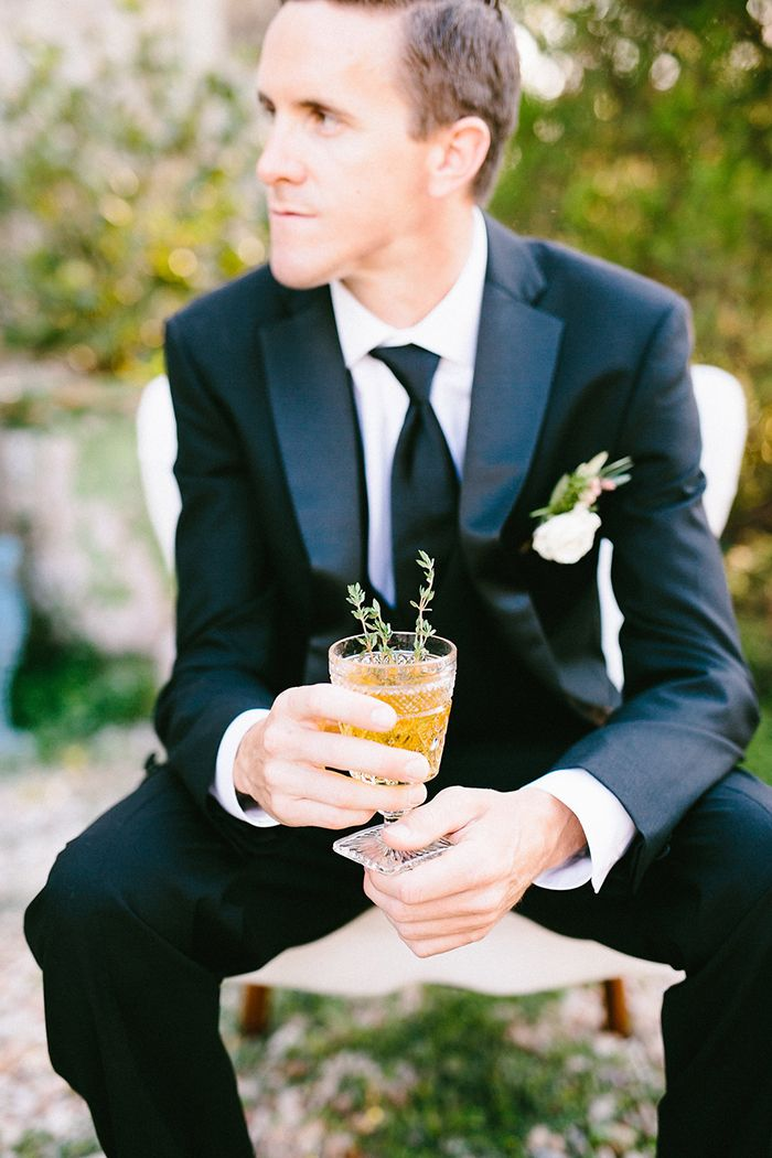 Stylish Black Tie Groom with a Craft Cocktail  https://heyweddinglady.com/craft-cocktails-summer-sun-european-style-wedding/    #wedding #weddings #weddingideas #texaswedding #groom #suit #cocktails