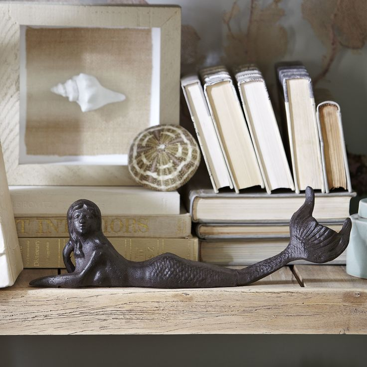 Lounging mermaid decor sculpted in a relaxed lounging pose this cast iron mermaid florida housesbirch lanehouse