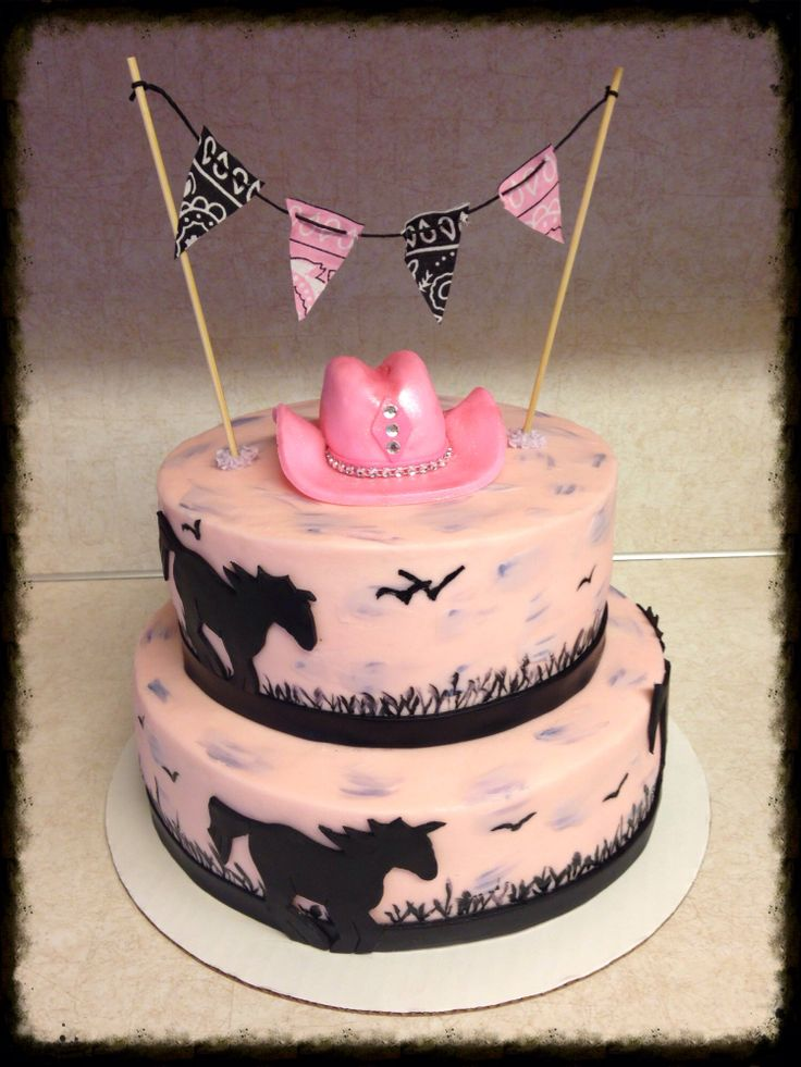Sweet cowgirl cake. Cake is iced with homemade buttercream icing and decorated with hand cut fondant horses, hand molded cowgirl hat and hand painted grass and birds. This cake is beautiful!  Www.facebook.com/devinedelightsbyangie  Www.devinedelightsbyangie.com