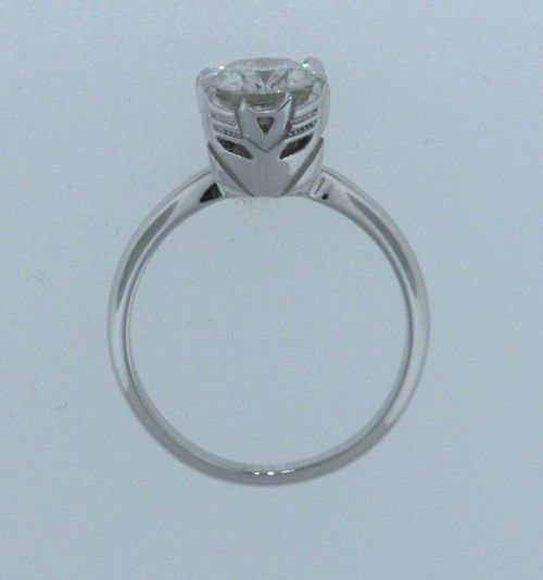 Transformers Wedding Ring. I don't know if this is coincidence or on purpose, either way its AWESOME.