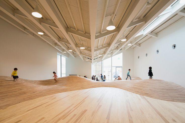 kengo kuma's community center contains an undulating playroom