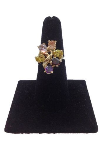A unique, twisted setting ring that features violet, yellow, and red cubic zirconias playing together in the light, for a brilliant display of icy fireworks. The cool beauty of our Fall Bouquet #ring is perfectly complimented by the polished stainless steel and sparkling cubic zirconias set into the band. Size 7.