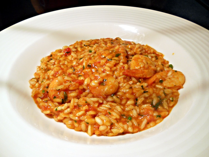 Seafood risotto with cherry tomatoes and fresh basil