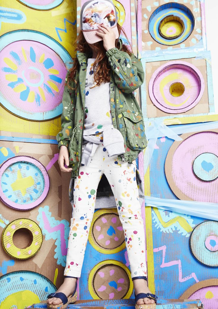 Paint splats cover denim, jumpers and military style jackets in a very colourful Stella McCartney Kids SS16 collection.