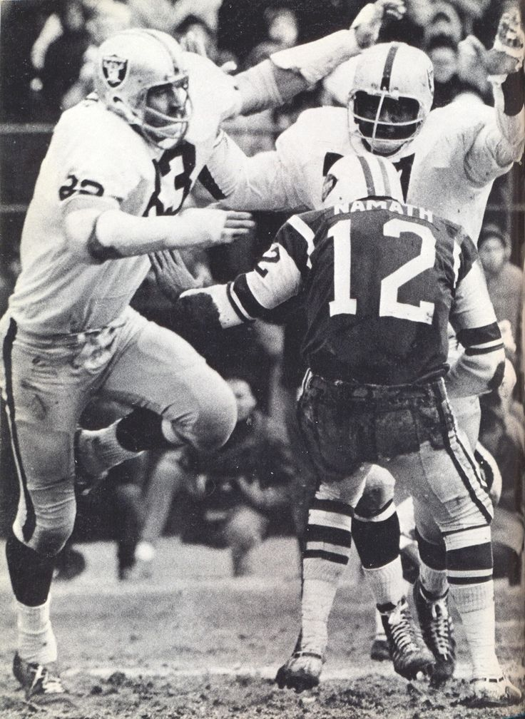 Ben Davidson and another oakland raider swarming Joe Namath