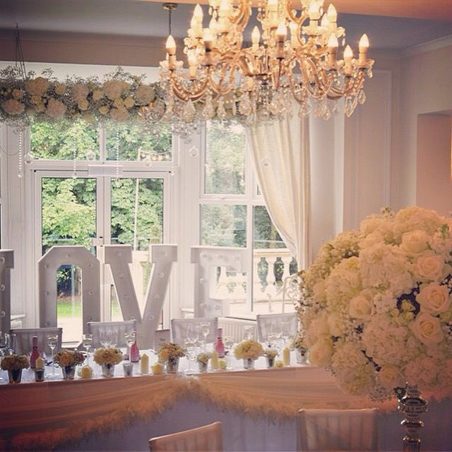 Chandeliers, love letters, fabulous flowers and feathers at Ashfield House.