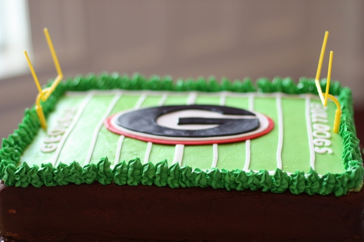 """Between the hedges Georgia bulldog cake - Georgia bulldog themed cake including the famous""""hedges"""" The cake is iced in butter cream, The decorations are fondant. The hedges are royal icing. The cake is red velvet."""