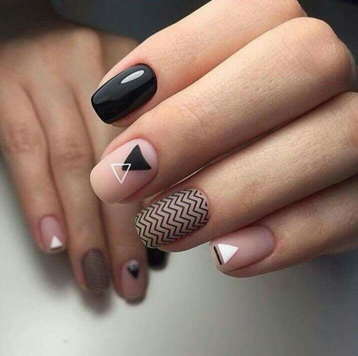Minimal nail art with nude, black and white polish.  ##nailart