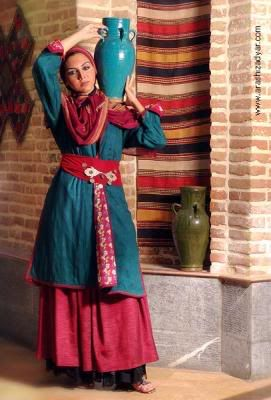 A styled photo, model in traditional Persian clothes. Love the teal and raspberry color combo.