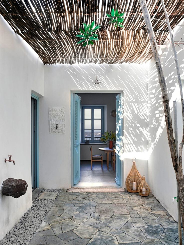 A 200-year-old #stone #building, perched on the cliff edge in Plaka, #Greece, is the authentic traditional #summer #retreat refurbished by k-studio for a London-based family