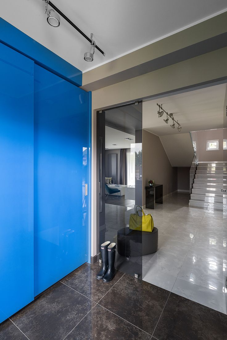 Colourful modern hall way, blue wardrobe, hunter