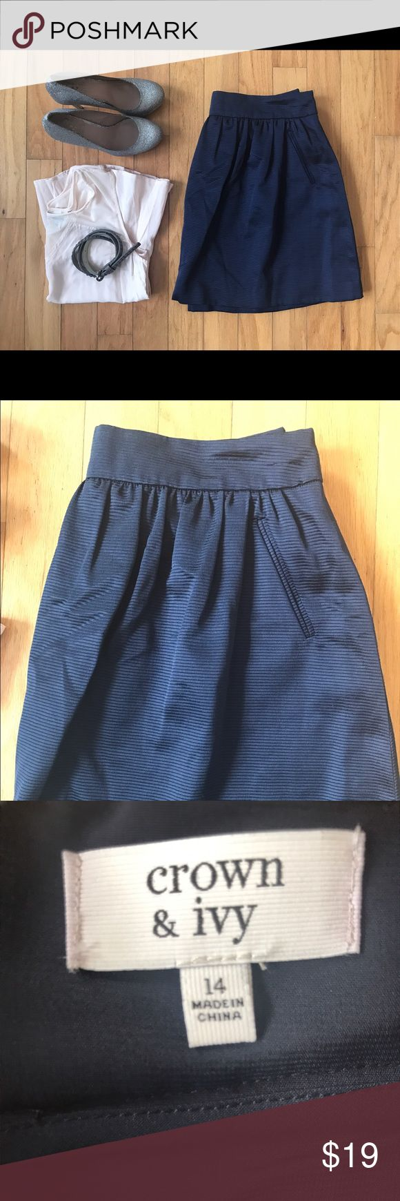 NWOT-Crown & Ivy Mini Skirt Size 14 Beautiful and feminine New Without Tags Crown & Ivy Midnight Blue Mini Bubble Skirt was originally $59.50. It's in excellent condition. Never worn. Only missing tags.   Features faux front pockets, zipper closure, and is fully lined. Material is textured with horizontal stripes and feels like thick silk. 56% Cotton, 44% Polyester.   Goes great with a plain tee & flats, or dressed up with a Blouse, heels & statement necklace!   Measurements taken lying…