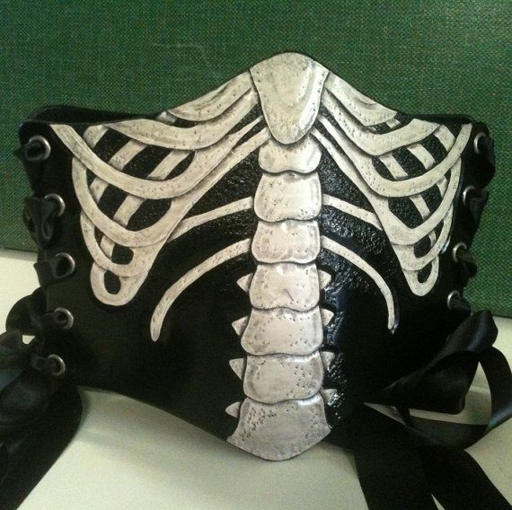 Whoa. The Ribcage...Hand Tooled Leather Skeleton Bones Ribbon Laced Waist Cincher Corset Belt. $360.00, via Etsy.