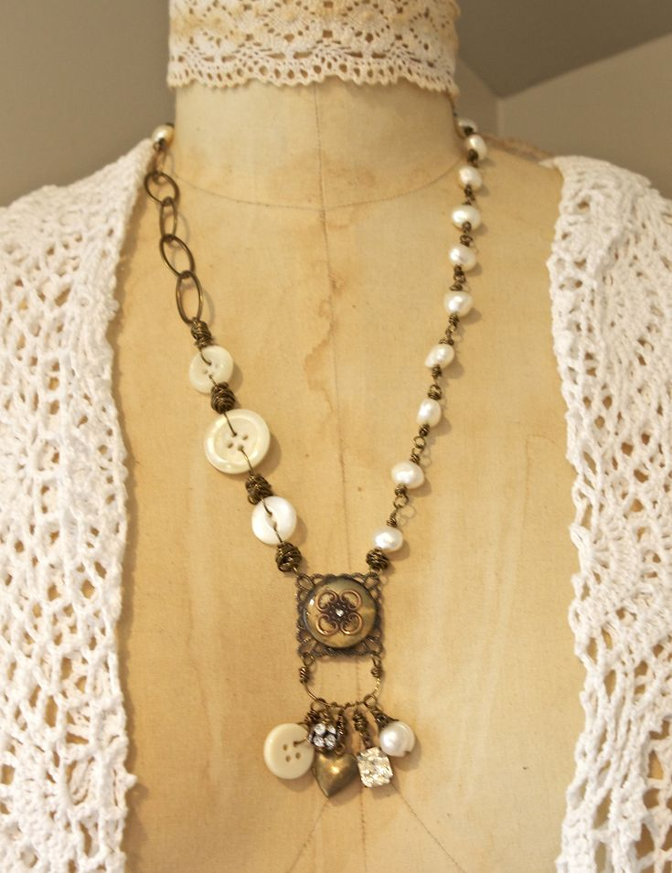 Hand wired necklace made with resin pendant with charms, vintage buttons and freshwater pearls.