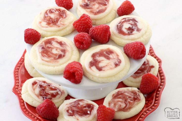 Raspberry Meltaway Cookies just melt in your mouth! Perfect topped with a simple almond glaze swirled with raspberry jam.