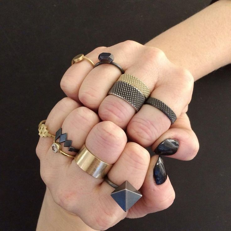 Janni Krogh Jewellery. All the rings.... oxidized sterling silver and 18kt gold